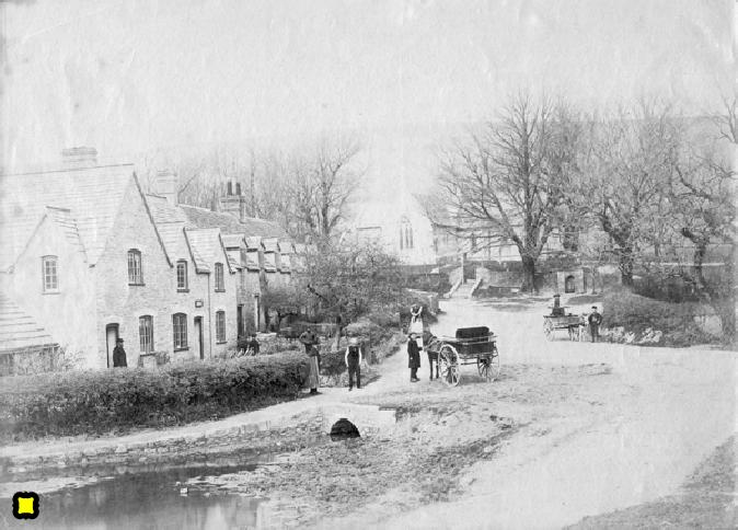 The Row at Tyneham circa 1900 with hedges before the stone wall was built